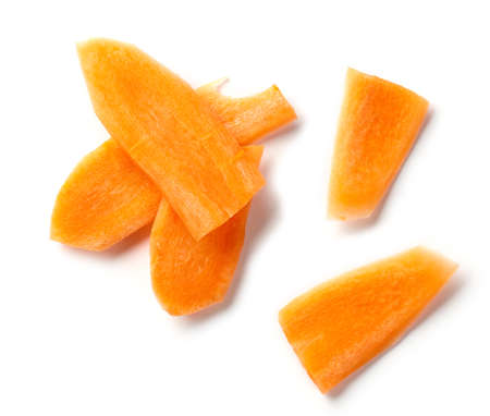 fresh raw carrot slices isolated on white background, top view 免版税图像