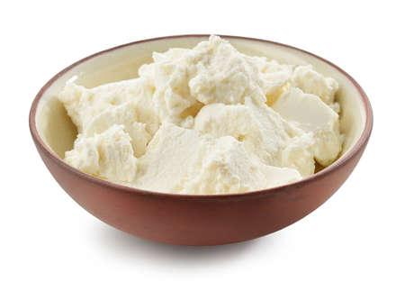 bowl of fresh homemade riccotta cheese isolated on white background Reklamní fotografie