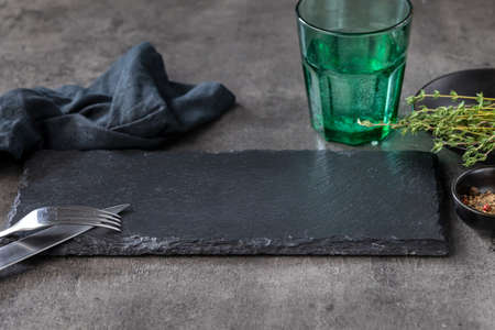 empty black stone plate on black restaurant table Reklamní fotografie