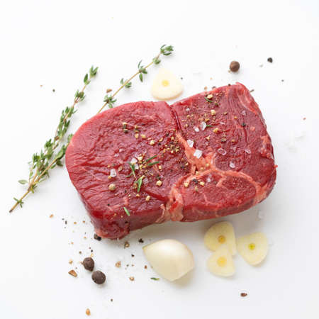 fresh raw beef steak meat and spices on white background, top view Reklamní fotografie