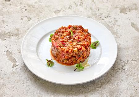 portion of ratatouille on white restaurant plate Reklamní fotografie