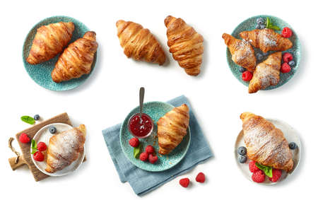 set of freshly baked croissant and jam on blue plate isolated on white background, top view