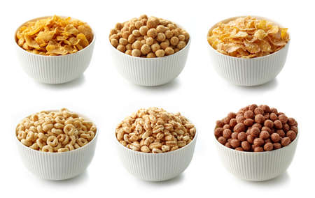bowls of various breakfast cereal isolated on white background