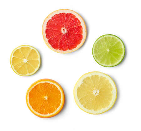 slices of various citrus fruit isolated on white background, top view Reklamní fotografie