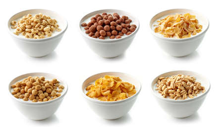 bowls of various cornflakes with milk isolated on white background