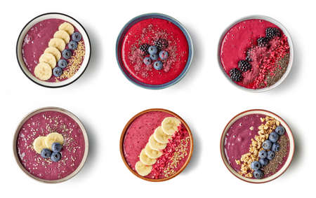 various healthy breakfast smoothie bowls of banana and berries isolated on white background, top view Reklamní fotografie