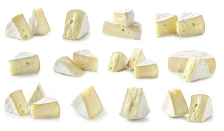 various pieces of fresh brie cheese isolated on white background