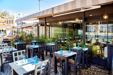 Alvor, Portugal - October 18, 2017: served fish restaurant table outside