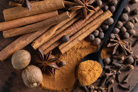 various spices on wooden board, top view Reklamní fotografie