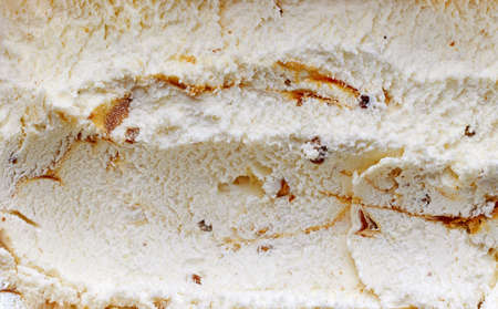 caramelized walnut and maple syrup ice cream background, top view
