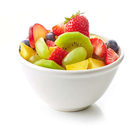 bowl of fruit salad. fresh fruit pieces foe healthy breakfast isolated on white background