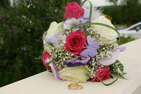 alliances: the bouquet of the bride  Stock Photo