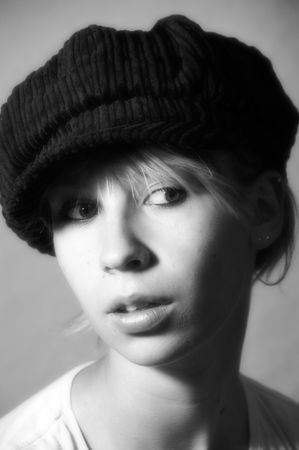 berets: woman, girl, hats, berets, accessory, fashion, style, innocence, expression, face, wind, hair, long hair, eyes, dreamy, beauty, feeling, emotion, black and white Stock Photo