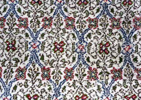 A close-up image of handmade Persian carpet photo