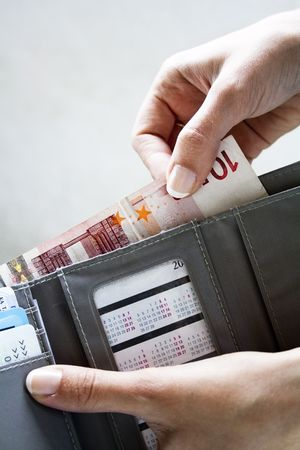 Female hands taking out money from the wallet Stock Photo
