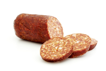 gastronome: Sliced smoked sausage isolated on white