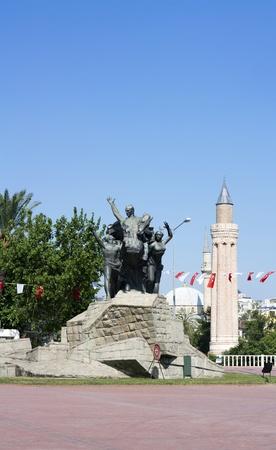 Monument of Mustafa Kemal Ataturk in Antalya, in background Yivli minaret photo