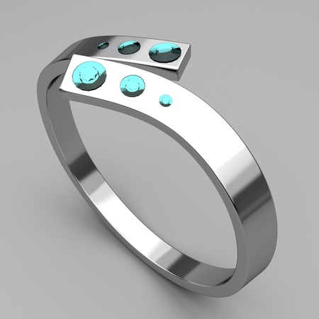 Silver ring with turquoise diamonds on gray background Stock Photo - 11541665