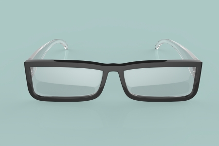 nearsighted: Front view of eyeglasses on green background Stock Photo