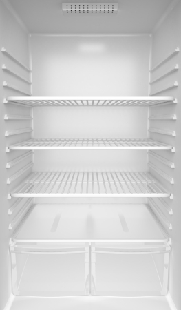 refrigerator: Inside of an empty white fridge