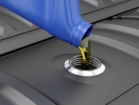 lubrication: Pouring oil from plastic bottle in the engine