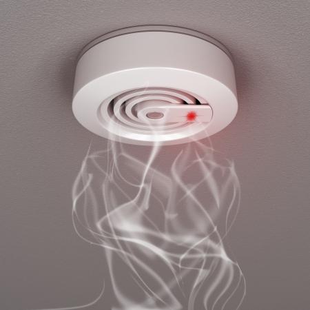 Smoke and fire detector with smoke Stock Photo