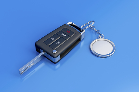 key fob: Car key with metal keyring on blue shiny background Stock Photo
