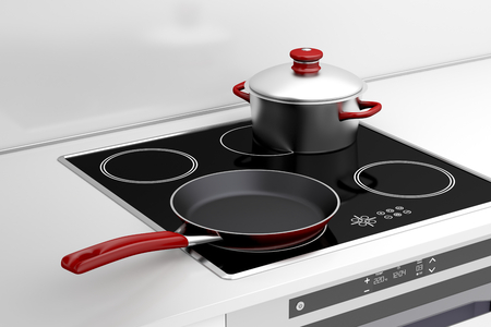 Frying pan and cooking pot at the induction stove Фото со стока - 29391266