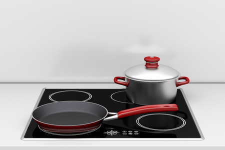 Pot and frying pan at the induction stove