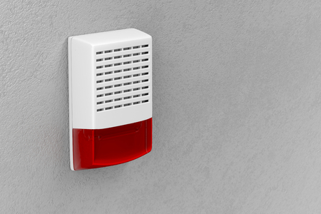 Alarm siren with flash light attached on wall Stock Photo