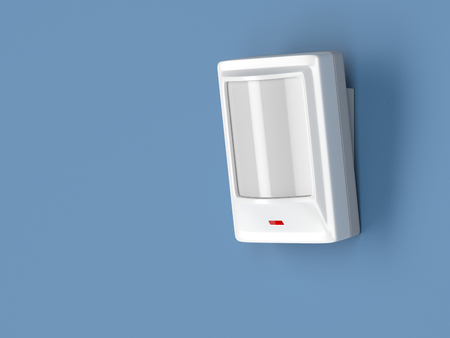 detector: Motion detector attached on blue wall Stock Photo