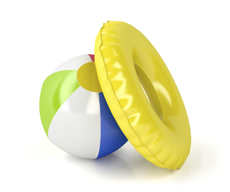Beach ball and swim ring on white background