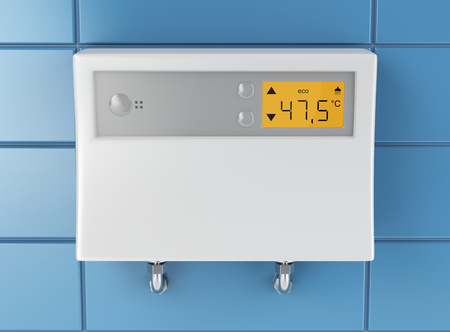 Automatic water heater attached on blue tiled wall Stockfoto