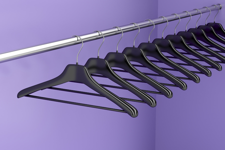 closet rod: Plastic hangers hanging on rod in the closet