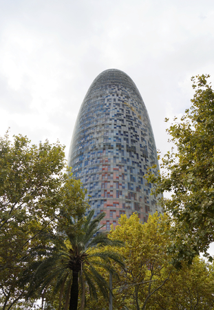 torre: BARCELONA, SPAIN - OCTOBER 08, 2015: Torre Agbar skyscraper, located between Avinguda Diagonal and Carrer Badajoz in Barcelona, Spain