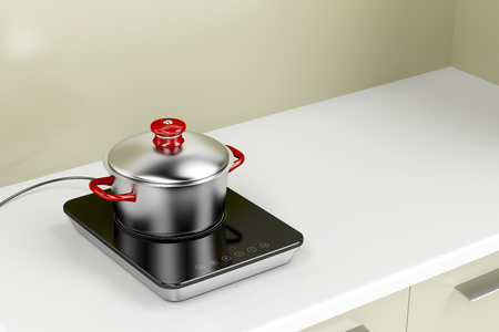 cooktop: Modern induction cooktop with cooking pot in the kitchen