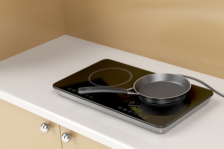 cooktop: Double induction cooktop with frying pan in the kitchen