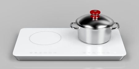cooktop: White induction cooktop and cooking pot on gray background