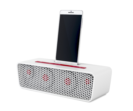 White docking station speaker and smartphone on white background Banque d'images