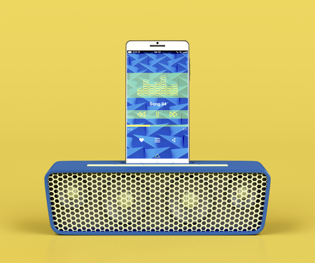 handsfree telephone: Front view of docking station speaker and smartphone on yellow background