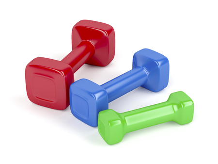 exercise equipment: Three dumbbells with different sizes and colors on white background