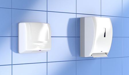 Automatic paper towel dispenser and hand dryer in public toilet Stockfoto