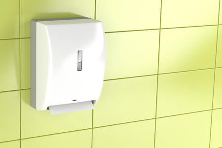 tiled wall: Automatic paper towel dispenser on green tiled wall