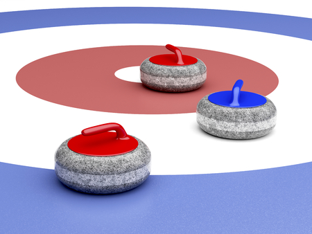 Curling stones near the target area Stock Photo