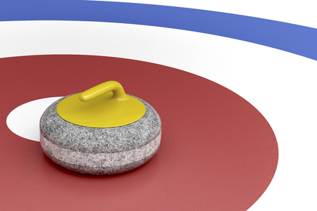Curling stone with yellow handle in the center of target area