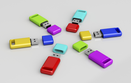 dongle: Group of usb memory sticks with different colors on shiny grey background