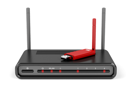 Wireless router and usb wireless network adapter on white background Stock Photo