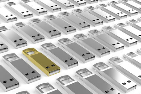 dongle: Group of silver usb sticks and one different in gold color Stock Photo