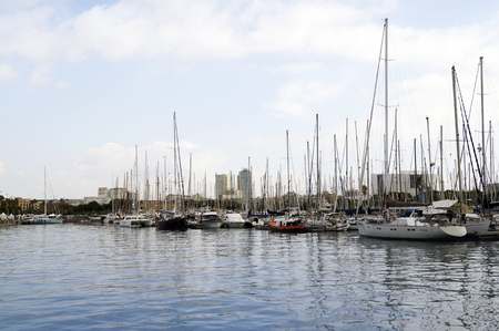 docked: BARCELONA, SPAIN - OCTOBER 09, 2015: Yachts parked at Port Vell in Barcelona, Spain