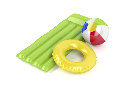 Pool raft, beach ball and swim ring on white background Stock Photo